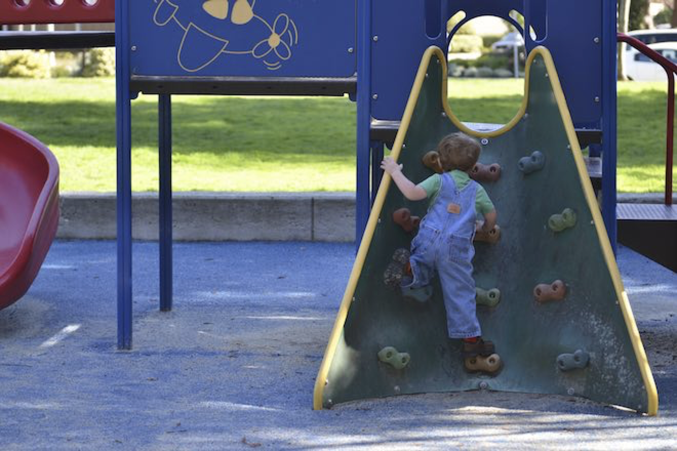 Kid climbing on a playground